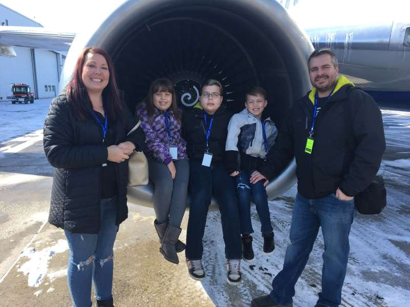 a group of people posing for the camera: Tyler Palmowsky and his family take an airplane tour on April 6, 2020