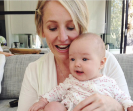 Fifi Box holding a baby: Fifi box shares sweet photos of daughter Trixie to commemorate her 7th birthday including an impressive birthday cake made in isolation with Daisy.