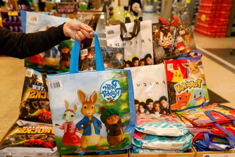 a stack of flyers on a table: Woolworths' wide array of Easter Showbags.