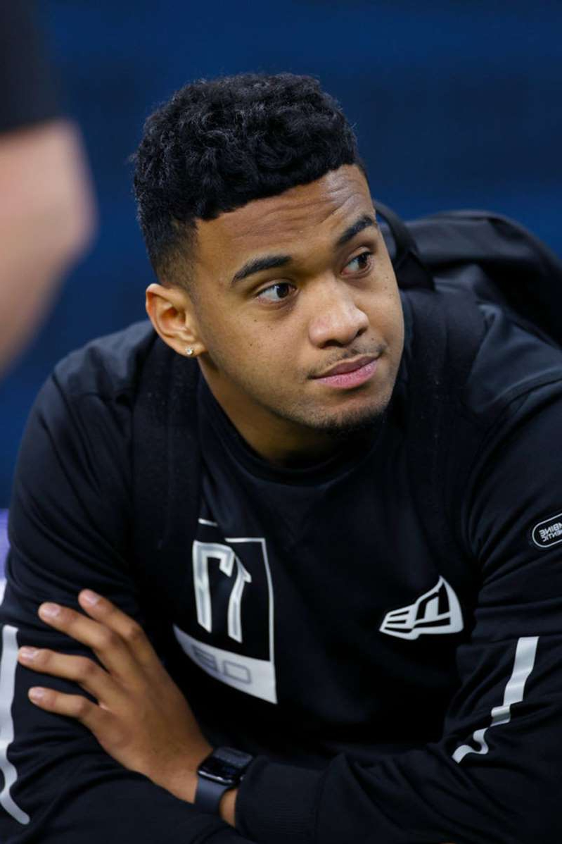 a man in a black shirt: Quarterback Tua Tagovailoa of Alabama looks on during NFL Scouting Combine at Lucas Oil Stadium in Indianapolis on February 27, 2020.