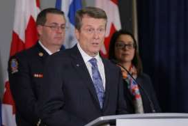 John Tory in a suit and tie: City officials have confirmed a case of COVID-19 inside Seaton House, one of the city's busiest shelters.
