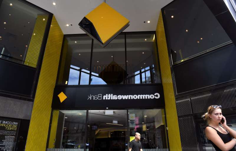 People walk past a branch of the Commonwealth Bank in Melbourne on February 6, 2019. - Australia's largest financial firm Commonwealth Bank on February 6 said profits fell six percent in the last six months of 2018 amid a 'challenging environment' for the business. (Photo by William WEST / AFP)        (Photo credit should read WILLIAM WEST/AFP/Getty Images)