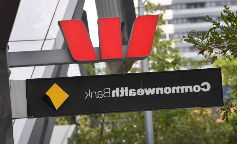 Signs adorn the branches of a Westpac and Commonwealth banks in Melbourne on February 4, 2019. - Australian banks admitted to failing customers and vowed to 'reset' their industry, as they braced for the release of a crunch report on February 4, into financial abuses in the sector. (Photo by William WEST / AFP)        (Photo credit should read WILLIAM WEST/AFP/Getty Images)