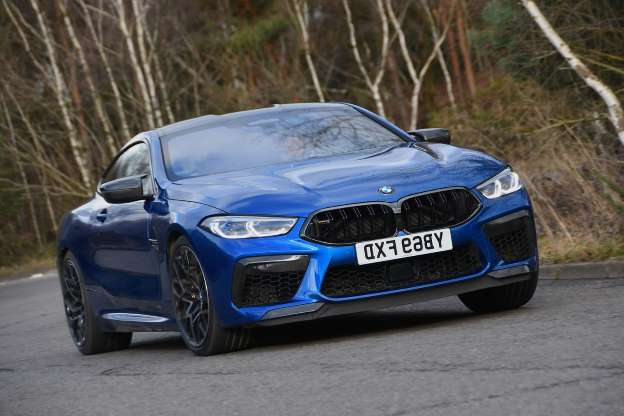 a blue car parked on the side of a road: BMW M8 Competition Coupe 2020 UK review