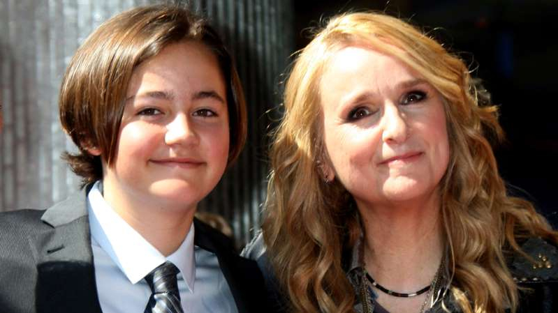 Melissa Etheridge wearing a suit and tie
