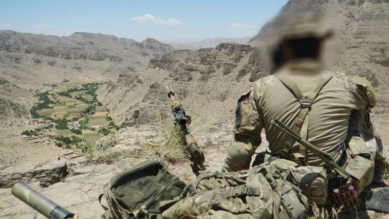 a group of people sitting on the side of a mountain: The Defence Force Inspector General has been investigating allegations about Australian soldiers in Afghanistan for four years. (Supplied)