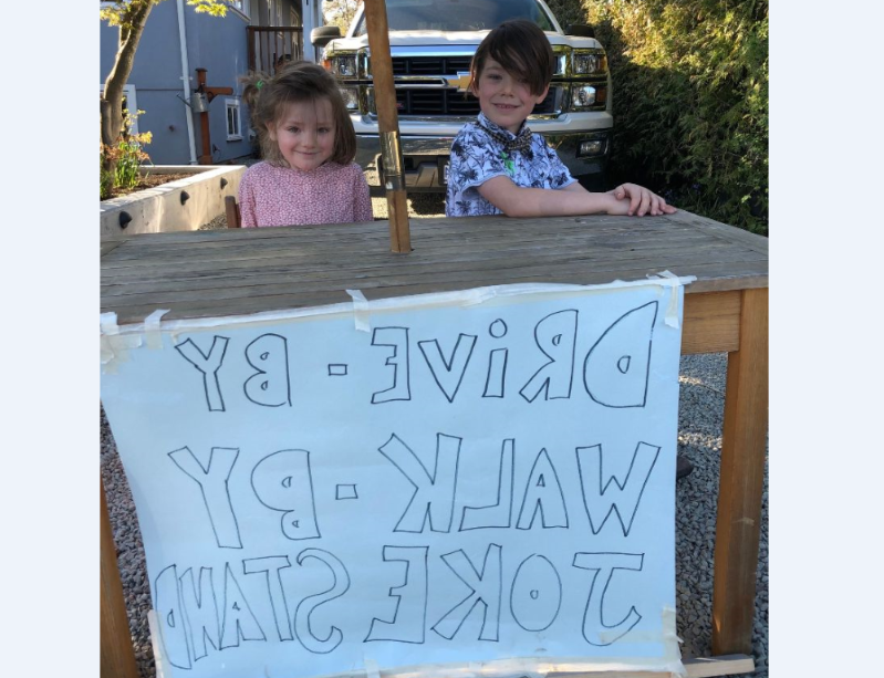 Callaghan McLaughlin, 6, at his joke booth with his little sister, Cayde, at the family home in British Columbia. (Kelsea McLaughlin)