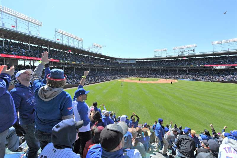 a crowd of people in a field: Wrigley Field in Chicago