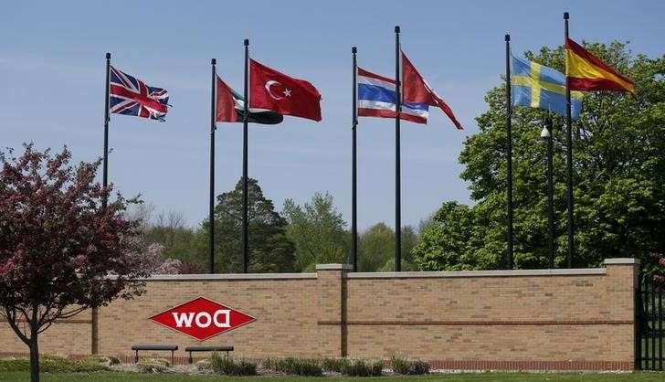 a red stop sign sitting on the side of a flag: FILE PHOTO: The Dow logo is seen at the entrance to Dow Chemical headquarters at the East Patrick street entrance in Midland, Michigan