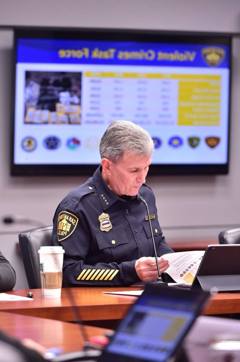 a man sitting at a table using a laptop computer: San Antonio Police Chief William McManus took disciplinary actions after five police officers recently.