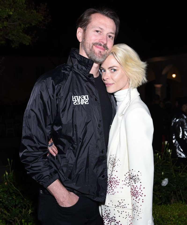 Jaime King, Kyle Newman are posing for a picture