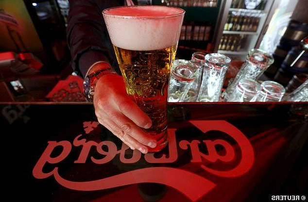 a cup of beer on a table: Carlsberg UK will be entitled to sell its portfolio of beers at Marston's 1,400 pubs