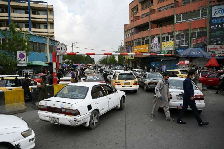 a car parked on a city street: The number of total coronavirus cases has doubled in Afghanistan in just 10 days