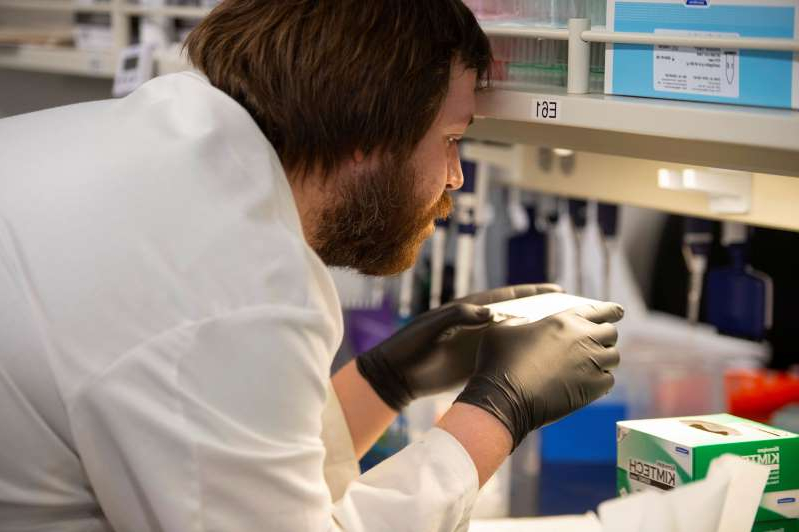 a close up of a man: FILE PHOTO: Researchers set up new labs to help fight coronavirus at the University of Minnesota