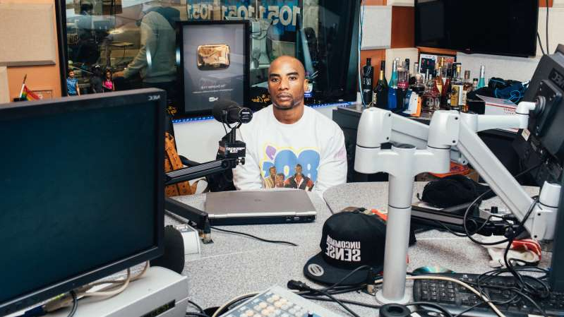 "a desktop computer sitting on top of a desk: Charlamagne Tha God, a host of ""The Breakfast Club,"" has created viral moments with rappers, actors and politicians in the radio show's nearly decade-long run."