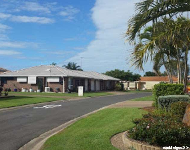 a house that has a sign on the side of a road: The smell was reported by residents at the Carlyle Gardens Retirement Village in the Townsville suburb of Condon, Queensland (pictured)