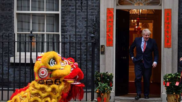 a person standing in front of a store: Boris Johnson celebrates Chinese New Year in January
