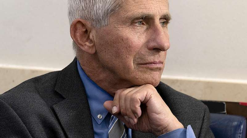 Anthony S. Fauci wearing a suit and tie: The Hill interview: Fauci on why a vaccine by end of year is 'aspirational'