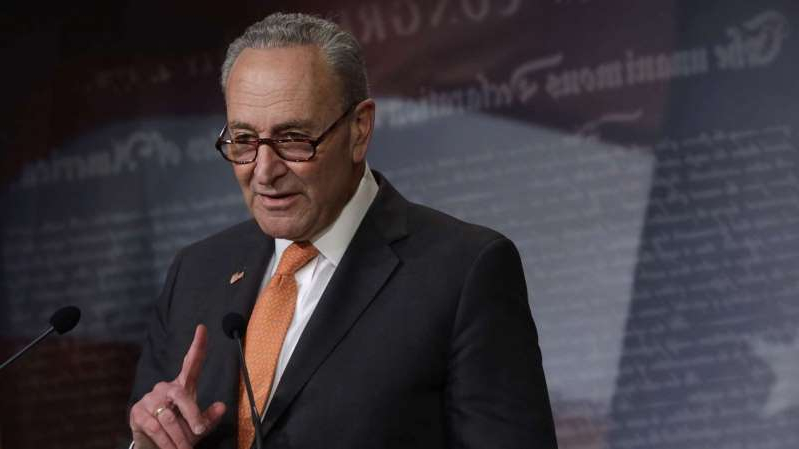 Chuck Schumer wearing a suit and tie: Senate Minority Leader Sen. Chuck Schumer speaks during a news briefing at the Capitol Hill, May 12, 2020 in Washington.