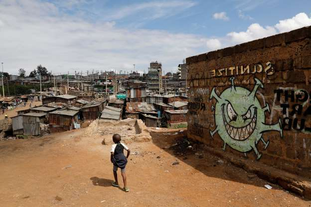 Slide 1 of 49: A boy walks in front of a graffiti promoting the fight against the coronavirus disease (COVID-19) in the Mathare slums of Nairobi, Kenya, May 22, 2020. REUTERS/Baz Ratner     TPX IMAGES OF THE DAY