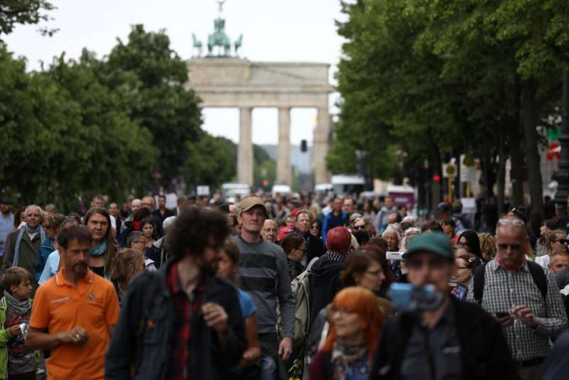 a group of people standing in front of a crowd: Coronavirus disease (COVID-19) outbreak in Berlin