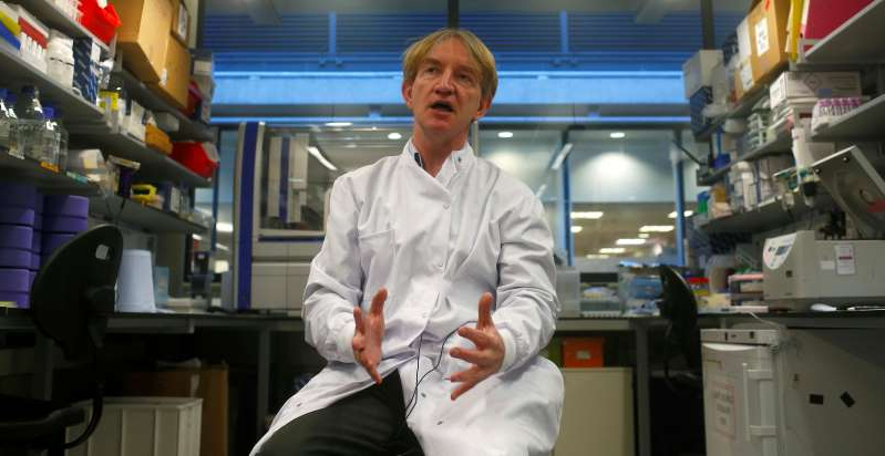 a man standing in a kitchen: FILE PHOTO: Professor Adrian Hill speaks to members of the media at The Jenner Institute in Oxford