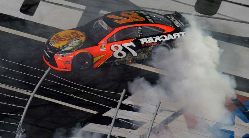 NASCAR Sprint Cup Series driver Martin Truex Jr. celebrates after winning the Coca-Cola 600 at Charlotte Motor Speedway in Concord, N.C., on May 29, 2016.