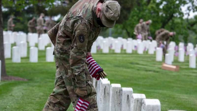 As the official ceremonial unit of the U.S. Army, The Old Guard places flags at every grave in Arlington National Cemetery each Memorial Day.