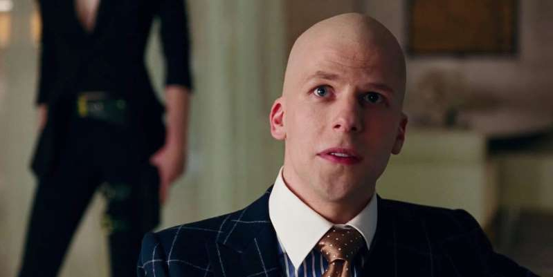 Jesse Eisenberg wearing a suit and tie: Justice League star Jesse Eisenberg has reacted to the news that the Snyder Cut will finally be released on HBO Max.