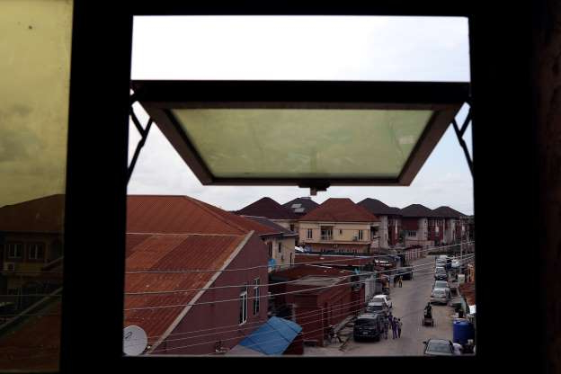 a close up of a window: A view is pictured from the window of Adetona Omokanye's' home in Lagos