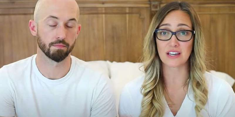 a man and a woman looking at the camera: A YouTuber is facing backlash after revealing she