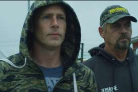 a man wearing a uniform: Kris and Brad Kelly on 'Bering Sea Gold'