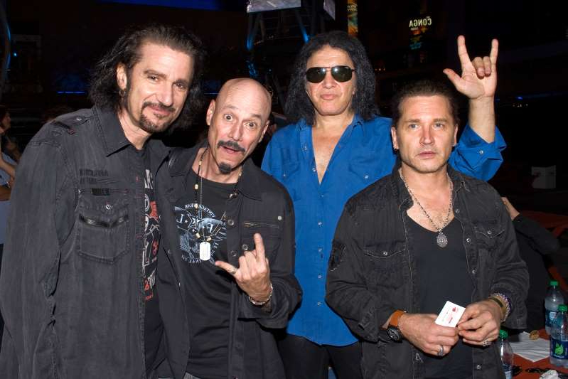 Eric Singer, Gene Simmons, Bob Kulick, Bruce Kulick posing for the camera: KISS alumni Eric Singer, Gene Simmons, Bob Kulick, and Bruce Kulick in 2012. (Photo: Jerod Harris/WireImage)