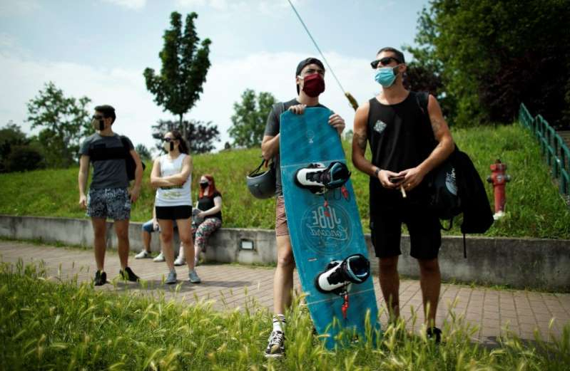 a man doing a trick on a skateboard: The coronavirus disease (COVID-19) outbreak in Milan