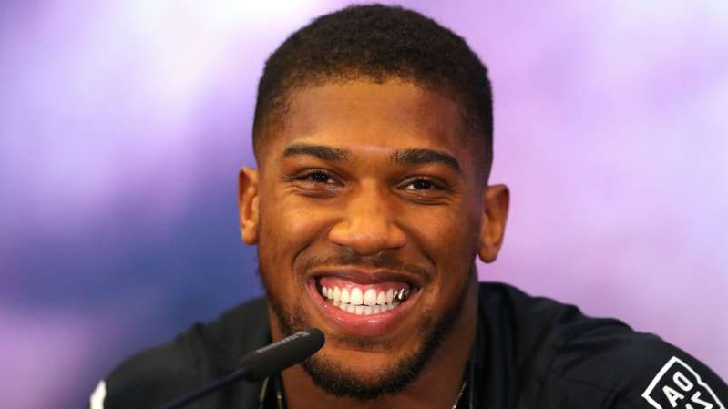 Anthony Joshua smiling for the camera