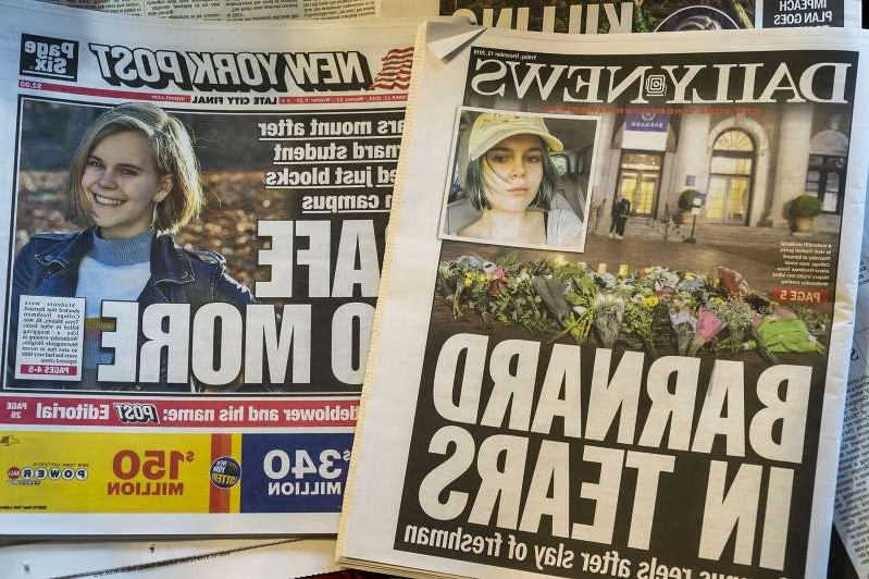 a close up of a newspaper: Front pages of New York newspapers on December 13, 2019, report on the murder of Barnard College student Tessa Majors in Morningside Park.