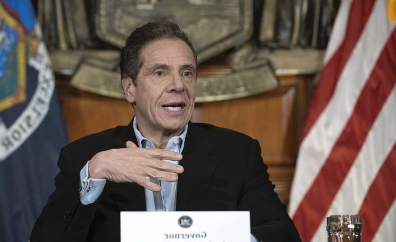Andrew Cuomo wearing a suit and tie