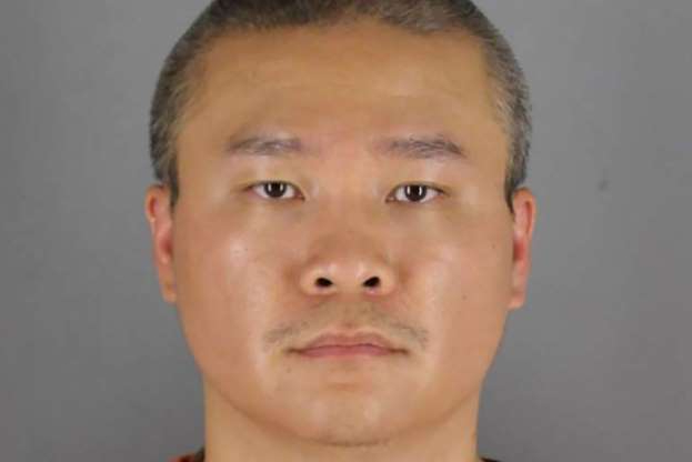 a person posing for the camera: Former Minnesota police officer Tou Thao poses for a booking photograph in Minneapolis