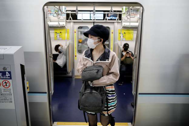 Slide 1 of 118: Passengers wearing protective face masks are seen amid the coronavirus disease (COVID-19) outbreak, at Tokyo Metro's newly-opened Toranomon Hills Station in Tokyo, Japan June 6, 2020. REUTERS/Issei Kato