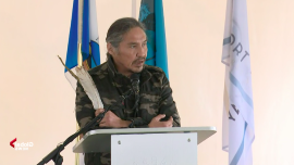 a person standing in front of a computer: Chief Allan Adam of the Athabascan Chipewyan First Nation.
