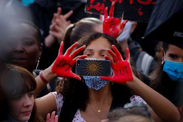 Slide 1 of 50: A woman takes a picture during a demonstration in Paris, France, Saturday, June 6, 2020, when protesting against the recent killing of George Floyd, a black man who died in police custody in Minneapolis, U.S.A., after being restrained by police officers on May 25, 2020. Further protests are planned over the weekend in European cities, some defying restrictions imposed by authorities because of the coronavirus pandemic. (AP Photo/Francois Mori)