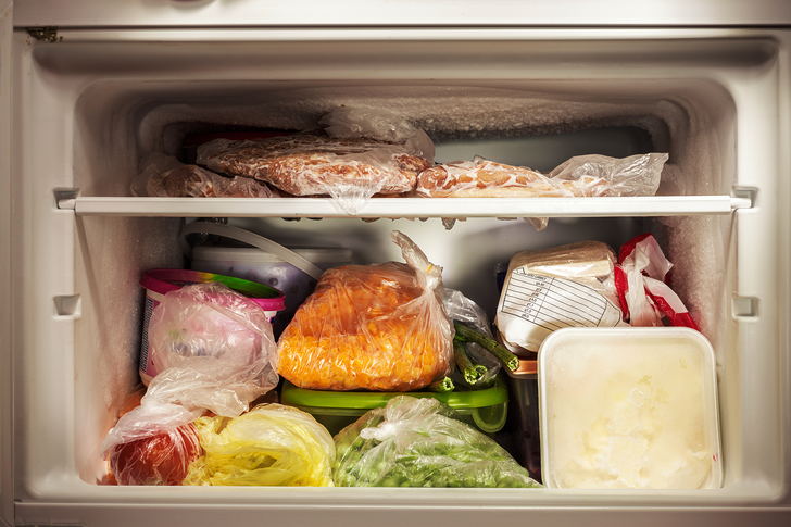 an open refrigerator filled with food: Not Carving Out Freezer Space