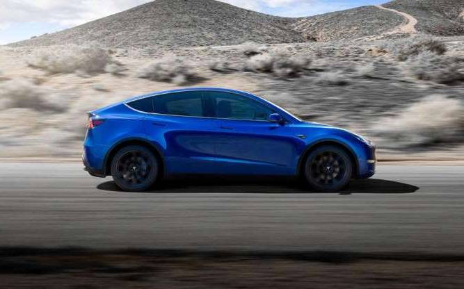 a blue car parked on the side of a road: Is the Model Y just not piquing interest like the Model 3? Tesla