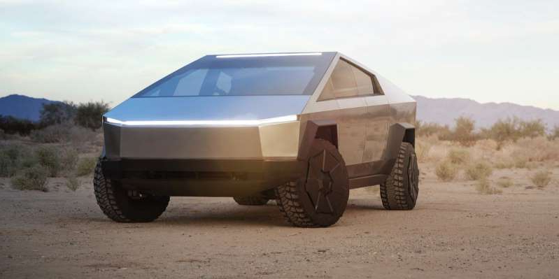 a car parked on a dirt road: Twitter user @TeslaTruckClub pitched the idea of a folding rear window and seats so items longer than eight feet can be stored in the electric pickup's bed.