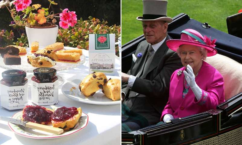 Elizabeth II sitting at a table with plates of food: Hello! Magazine