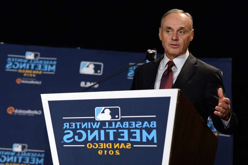 Rob Manfred wearing a suit and tie: On Wednesday, MLB commissioner Rob Manfred sounded as if he had a deal with the players.