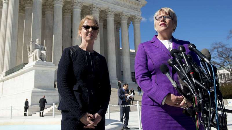a woman standing in front of a building: Amy Hagstrom Miller and Nancy Northup speak to the media outside of the Supreme Court in Washington, DC, March 2, 2016, following oral arguments in the case of Whole Woman's Health v. Hellerstedt, which deals with access to abortion.
