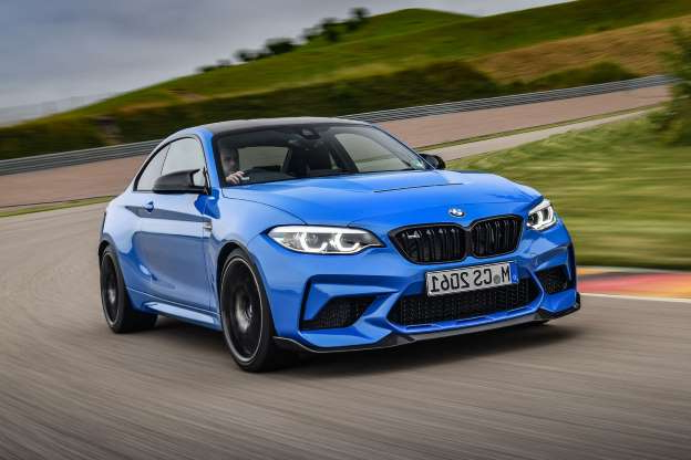a blue car on a road: BMW M2 CS 2020 review