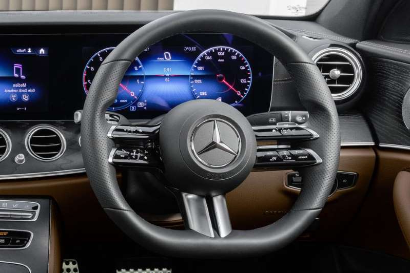 a close up of a car: That's one dramatically styled steering wheel. Mercedes-Benz