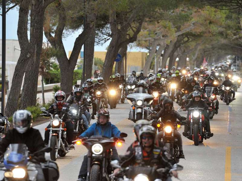 a group of people riding on the back of a motorcycle: As the country continues its reopening, Italy's Biker Fest has been moved back onto the calendar, with new events.